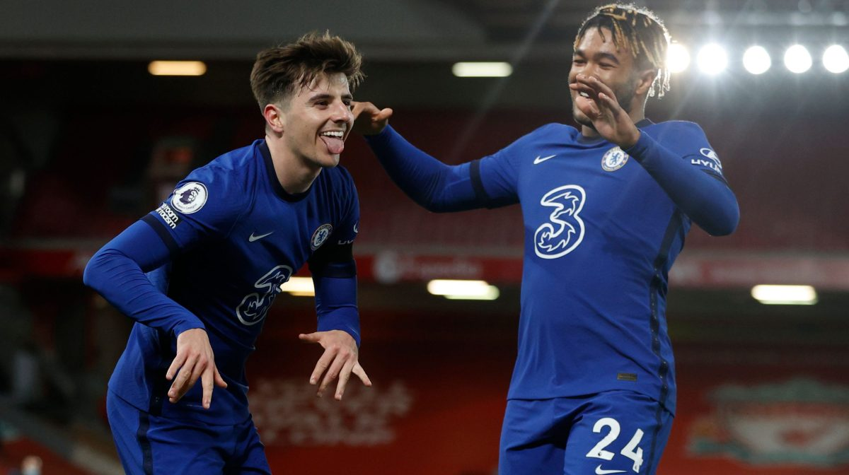 Chelsea's English midfielder Mason Mount (L) celebrates scoring the opening goal during the English Premier League football match between Liverpool and Chelsea at Anfield in Liverpool, north west England on March 4, 2021.
