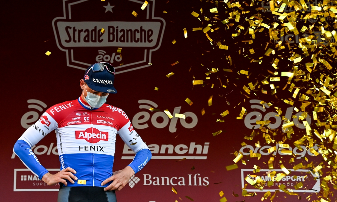 Dutch Mathieu van der Poel of Alpecin-Fenix celebrates on the podium after winning the 'Strade Bianche' one day cycling race (184km) from and to Siena, Italy, Saturday 06 March 2021. BELGA PHOTO DIRK WAEM (Photo by DIRK WAEM/BELGA MAG/AFP via Getty Images)