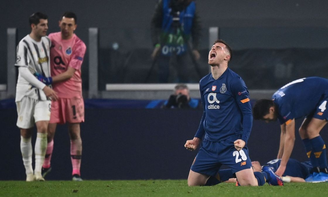 FC Porto's Spanish forward Toni Martinez (C-R) celebrates as FC Porto's Argentinian goalkeeper Agustin Marchesin (2ndL Rear) comforts Juventus' Spanish forward Alvaro Morata at the end of the UEFA Champions League round of 16 second leg football match between Juventus Turin and FC Porto on March 9, 2021 at the Juventus stadium in Turin. (Photo by Marco BERTORELLO / AFP) (Photo by MARCO BERTORELLO/AFP via Getty Images)