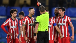 Referee Daniele Orsato (C) shows the red card to Atletico Madrid's Montenegrin defender Stefan Savic (R) during the UEFA Champions League round of 16 second leg football match between Chelsea and Atletico Madrid at Stamford Bridge in London on March 17, 2021.