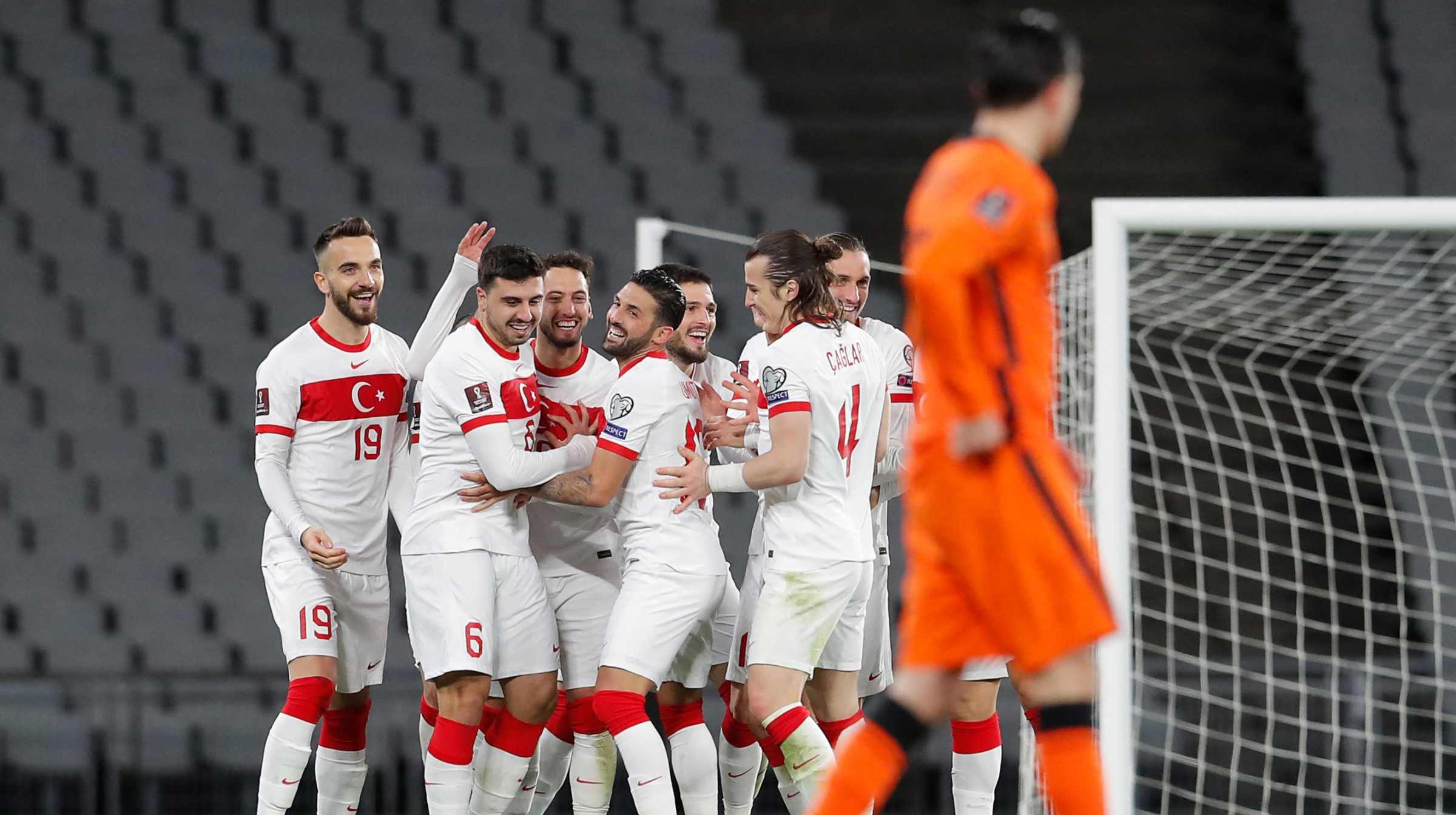 Turkey's players celebrate after scoring their teams's third goal during the FIFA World Cup Qatar 2022 qualification Group G football match between Turkey and The Netherlands at the Ataturk Olympic Stadium, in Istanbul, on March 24, 2021.