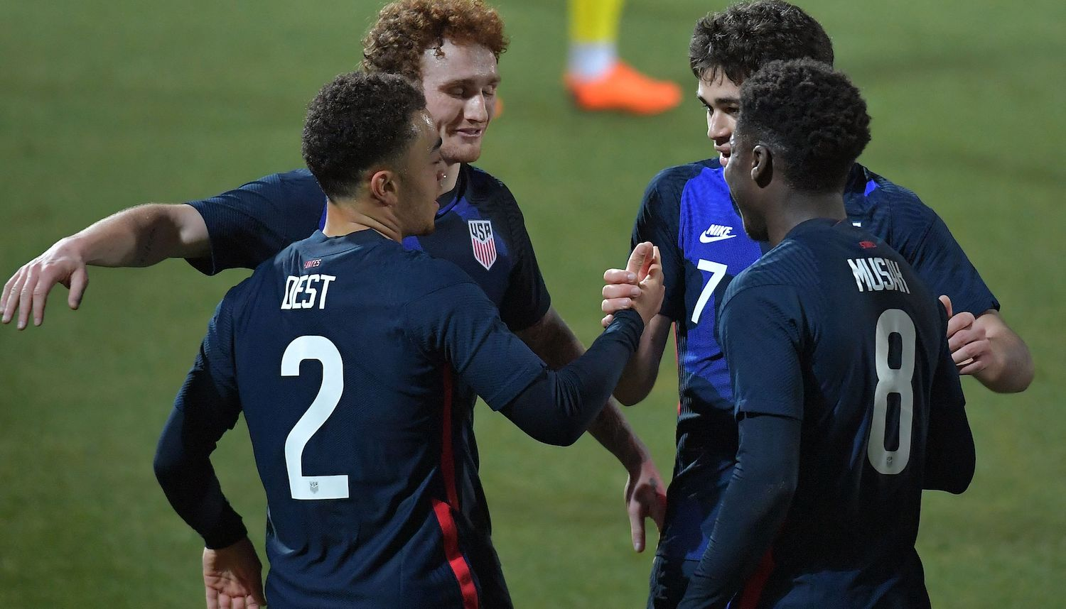 United States' defender Sergino Dest (L) celebrates after scoring the 1-0 during the FIFA World Cup Qatar 2022 friendly preparation football match USA v Jamaica in Vienna, on March 25, 2021. (Photo by JAKUB SUKUP / AFP) (Photo by JAKUB SUKUP/AFP via Getty Images)