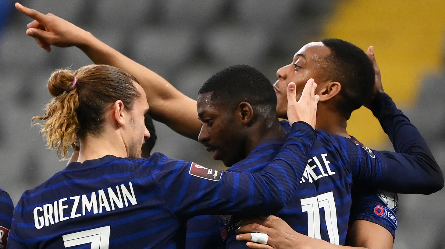 France's forward Ousmane Dembele (C) celebrates with France's forward Antoine Griezmann (L) and France's forward Anthony Martial (R) teammates after scoring a goal during the FIFA World Cup Qatar 2022 qualification Group D football match between Kazakhstan and France, at the Astana Arena, in Nur-Sultan, on March 28, 2021.