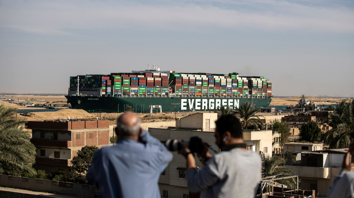 SUEZ, EGYPT - MARCH 29: The container ship 'Ever Given' is refloated, unblocking the Suez Canal on March 29, 2021 in Suez, Egypt. This morning the container ship came partly unstuck from the shoreline, where it ran aground in the canal last Tuesday, and later resumed its course shortly after 3pm local time. The Suez Canal is one of the world's busiest shipping lanes and the blockage had created a backlog of vessels at either end, raising concerns over the impact on global shipping and supply chains. (Photo by Mahmoud Khaled/Getty Images)