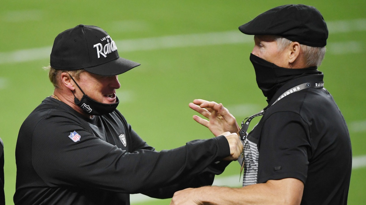LAS VEGAS, NEVADA - SEPTEMBER 21: Head coach Jon Gruden (L) and general manager Mike Mayock of the Las Vegas Raiders celebrate on the field after the Raiders defeated the New Orleans Saints 34-24 in the NFL game at Allegiant Stadium on September 21, 2020 in Las Vegas, Nevada. (Photo by Ethan Miller/Getty Images)