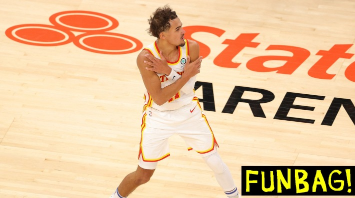 ATLANTA, GEORGIA - JANUARY 20: Trae Young #11 of the Atlanta Hawks reacts after hitting a three-point basket in the final seconds of their 123-115 win over the Detroit Pistons during overtime at State Farm Arena on January 20, 2021 in Atlanta, Georgia. NOTE TO USER: User expressly acknowledges and agrees that, by downloading and or using this photograph, User is consenting to the terms and conditions of the Getty Images License Agreement. (Photo by Kevin C. Cox/Getty Images)