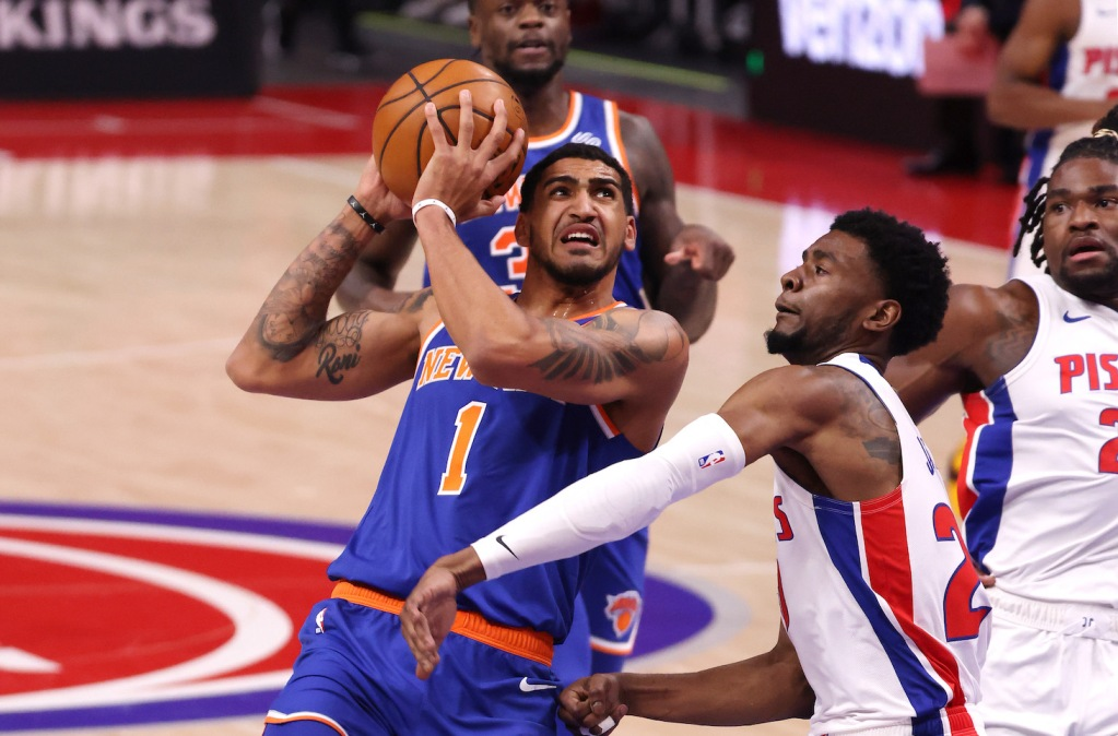 DETROIT, MICHIGAN - FEBRUARY 28: Obi Toppin #1 of the New York Knicks drives to the basket against Josh Jackson #20 of the Detroit Pistons during the first half at Little Caesars Arena on February 28, 2021 in Detroit, Michigan. NOTE TO USER: User expressly acknowledges and agrees that, by downloading and or using this photograph, User is consenting to the terms and conditions of the Getty Images License Agreement. (Photo by Gregory Shamus/Getty Images)