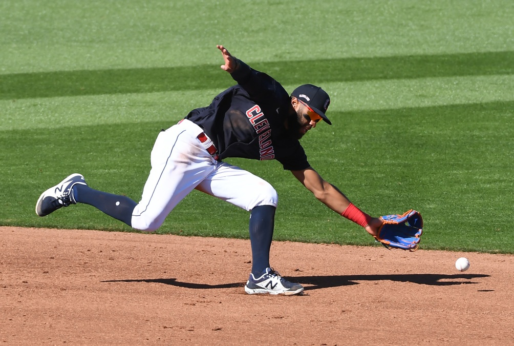 Amed Rosario of Cleveland can't get to a ground ball during a spring training game.