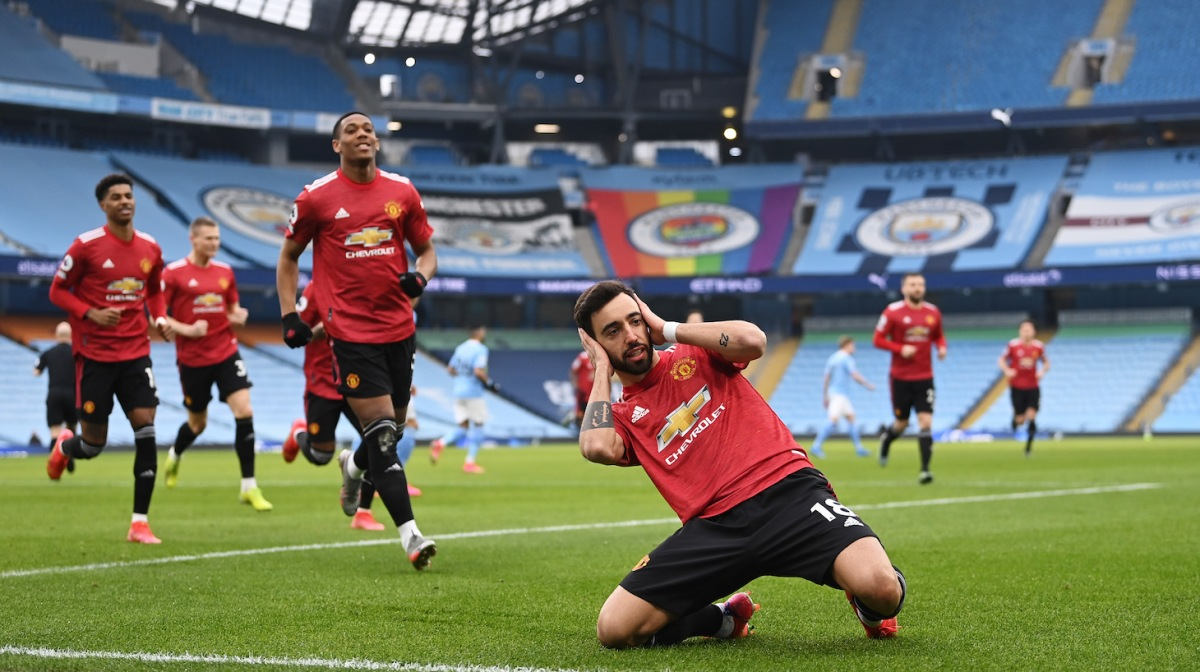 Bruno Fernandes of Manchester United celebrates after scoring their side's first goal from the penalty spot during the Premier League match between Manchester City and Manchester United at Etihad Stadium on March 07, 2021 in Manchester, England.