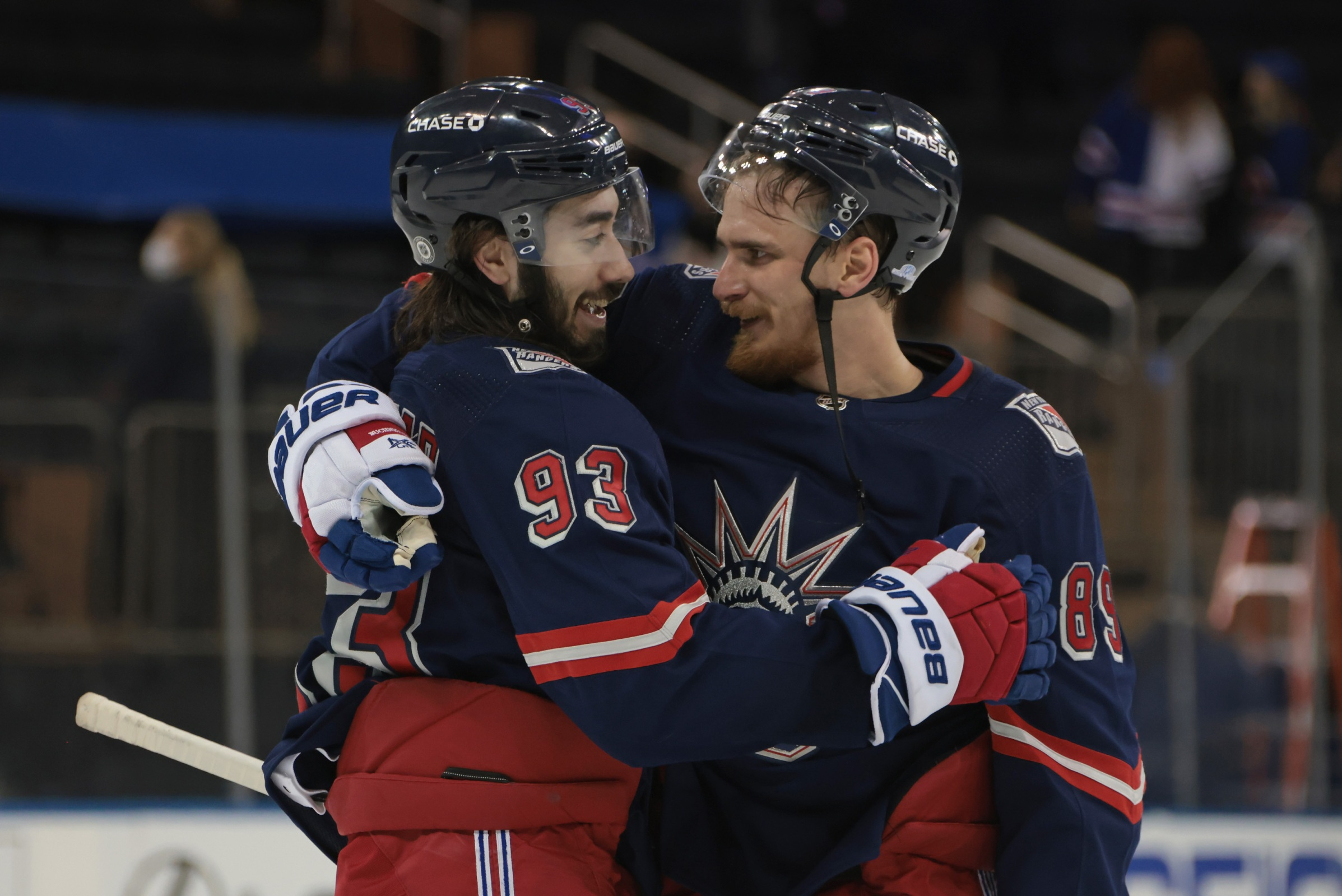 Mika Zibanejad #93 and Pavel Buchnevich #89 of the New York Rangers