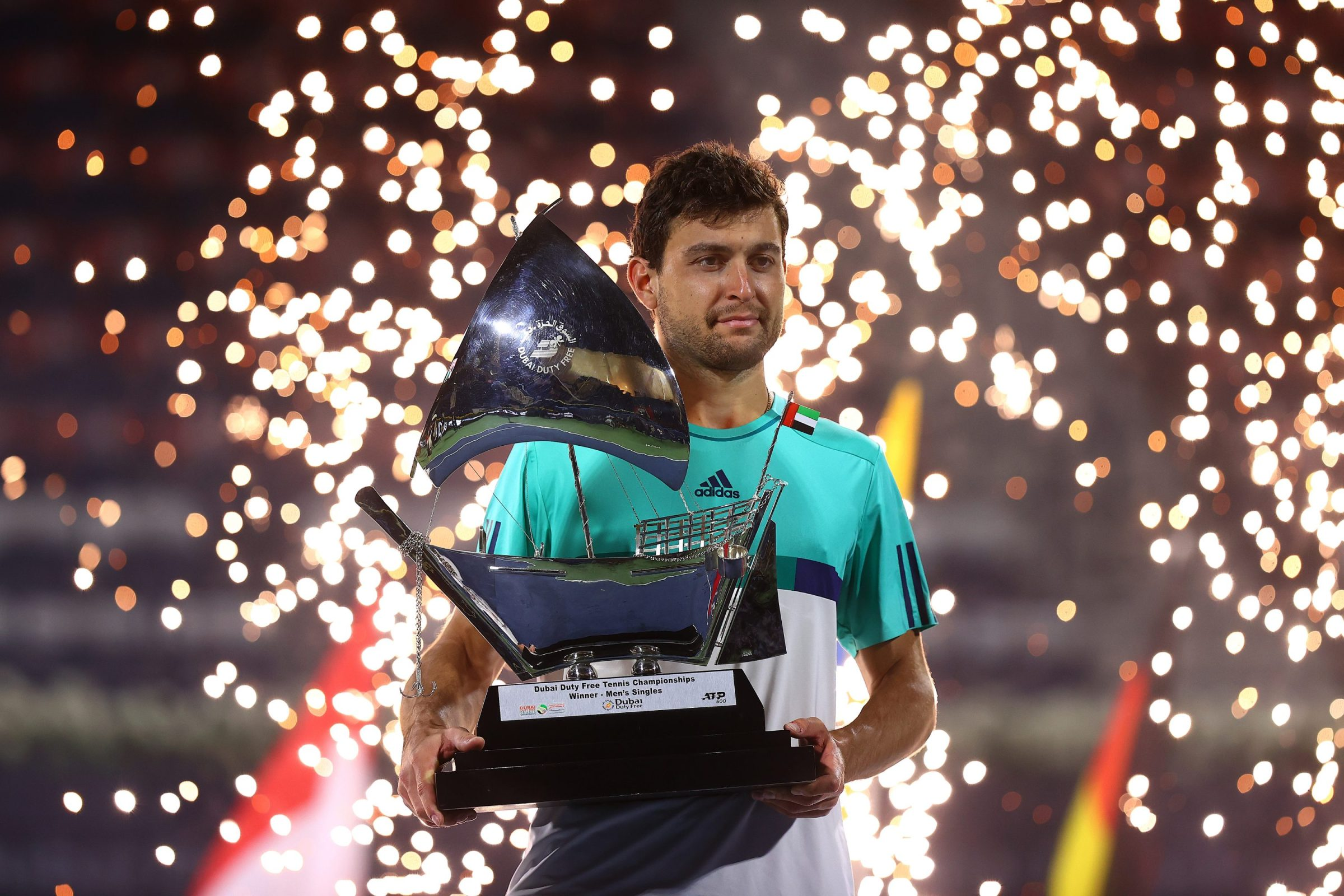 Aslan Karatsev holds the trophy at Dubai.