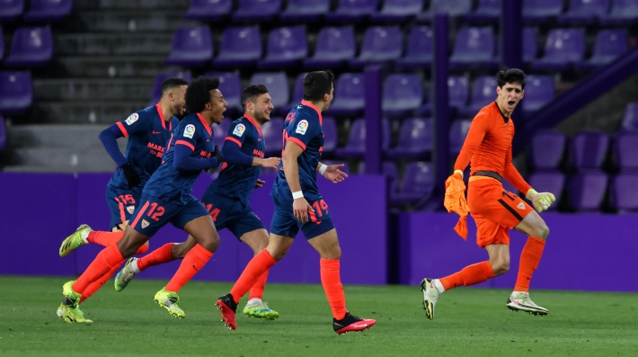 Yassine Bounou of Sevilla FC celebrates with teammates after scoring their team's first goal during the La Liga Santander match between Real Valladolid CF and Sevilla FC at Estadio Municipal Jose Zorrilla on March 20, 2021 in Valladolid, Spain.
