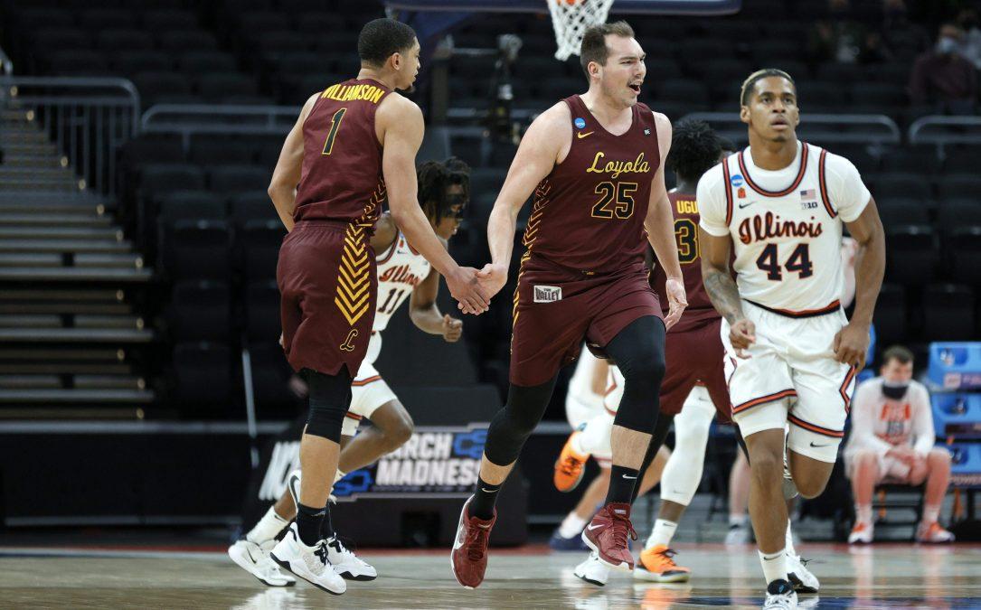 Cameron Krutwig celebrates a basket.
