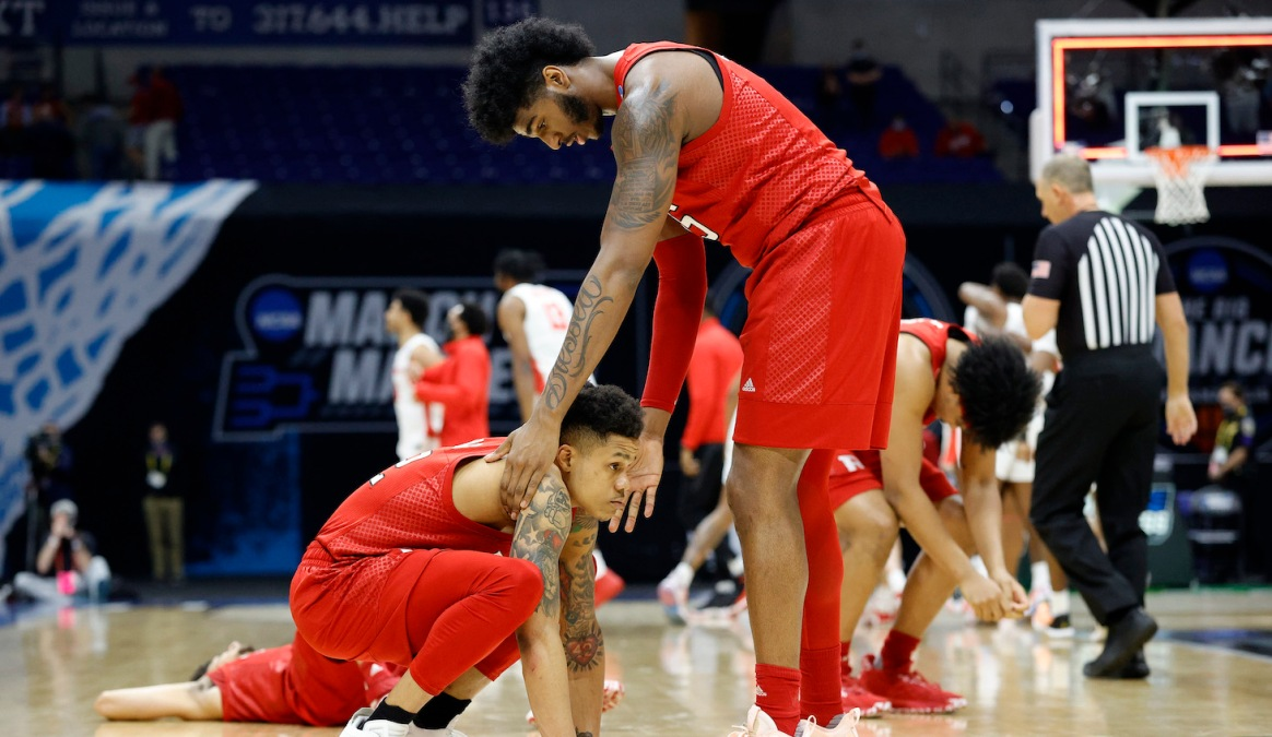 INDIANAPOLIS, INDIANA - MARCH 21: Jacob Young #42 and Myles Johnson #15 of the Rutgers Scarlet Knights react after being defeated by the Houston Cougars 63-60 in the second round game of the 2021 NCAA Men's Basketball Tournament at Lucas Oil Stadium on March 21, 2021 in Indianapolis, Indiana. (Photo by Tim Nwachukwu/Getty Images)