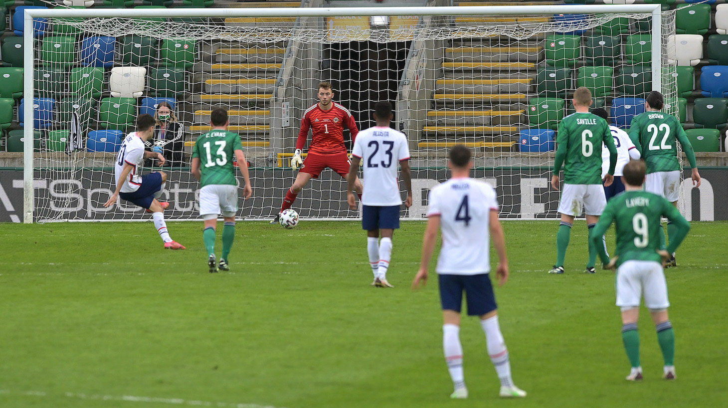 Christian Pulisic of USA scores their side's second goal past Conor Hazard of Northern Ireland during the International Friendly between Northern Ireland and USA at Windsor Park on March 28, 2021 in Belfast, Northern Ireland.
