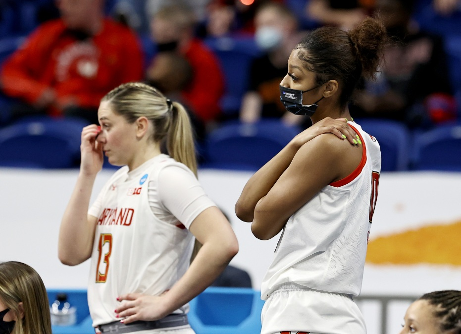 Faith Masonius #13 and Angel Reese #10 of the Maryland Terrapins react to the loss to the Texas Longhorns during the Sweet Sixteen round of the NCAA Women's Basketball Tournament at the Alamodome on March 28, 2021 in San Antonio, Texas.The Texas Longhorns defeated the Maryland Terrapins 64-61