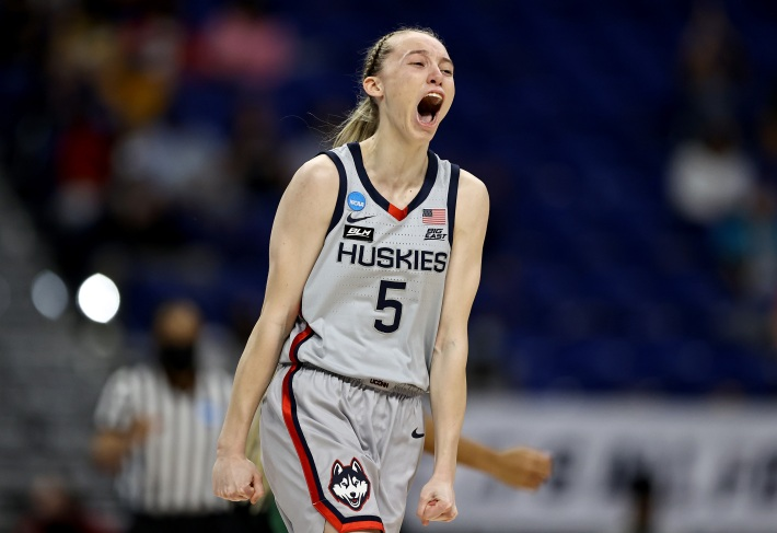 Paige Bueckers #5 of the UConn Huskies celebrates her three point basket in the first quarter against the Baylor Lady Bears during the Elite Eight round of the NCAA Women's Basketball Tournament at the Alamodome on March 29, 2021 in San Antonio, Texas.