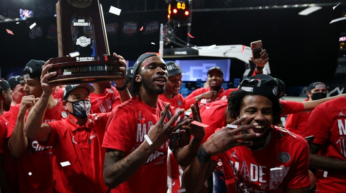 The Houston Cougars celebrate after defeating the Oregon State Beavers in the Elite Eight round of the 2021 NCAA Men's Basketball Tournament at Lucas Oil Stadium on March 29, 2021 in Indianapolis, Indiana