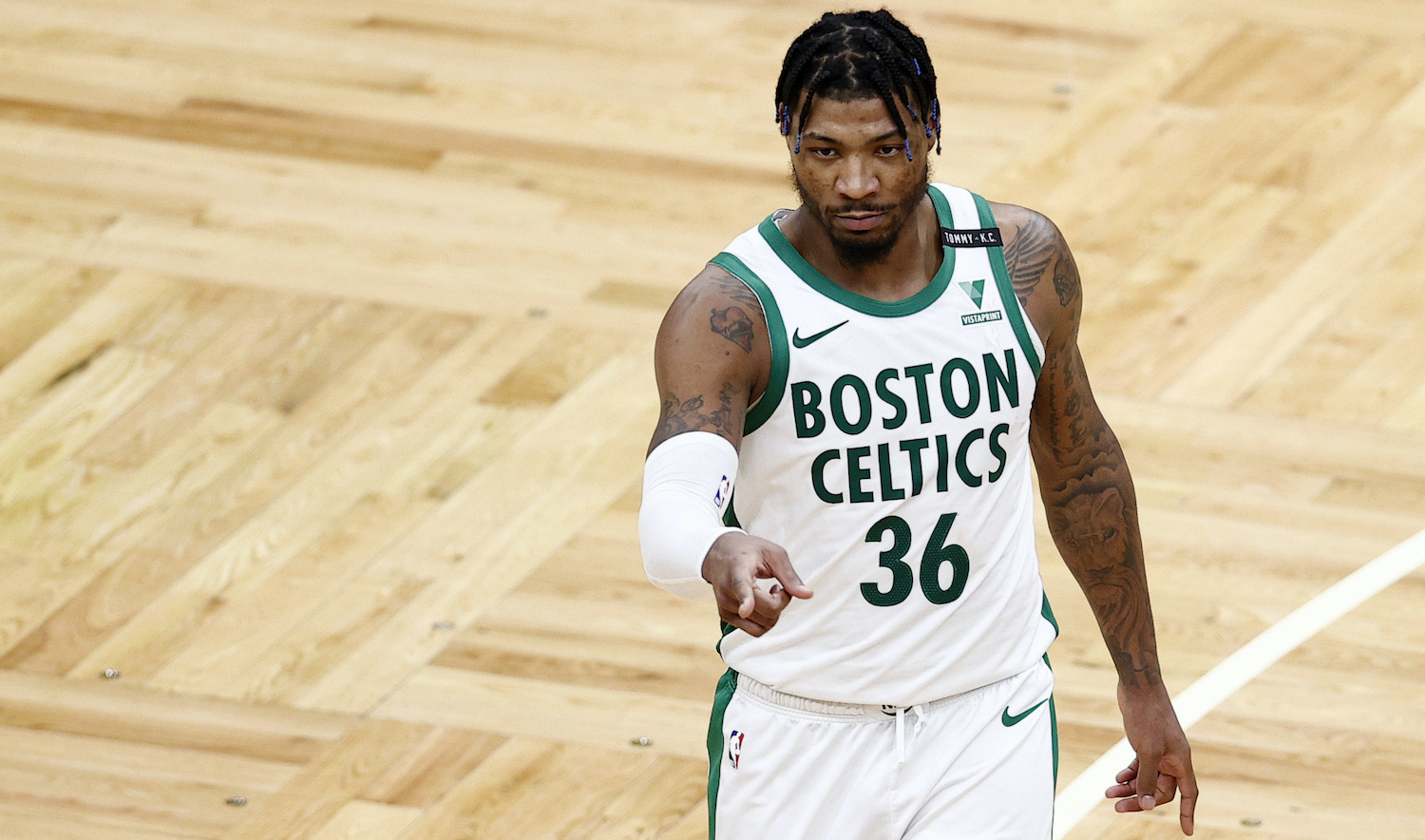 BOSTON, MASSACHUSETTS - MARCH 29: Marcus Smart #36 of the Boston Celtics reacts during the second half against the New Orleans Pelicansat TD Garden on March 29, 2021 in Boston, Massachusetts. The Pelicans defeat the Celtics 115-109. (Photo by Maddie Meyer/Getty Images)