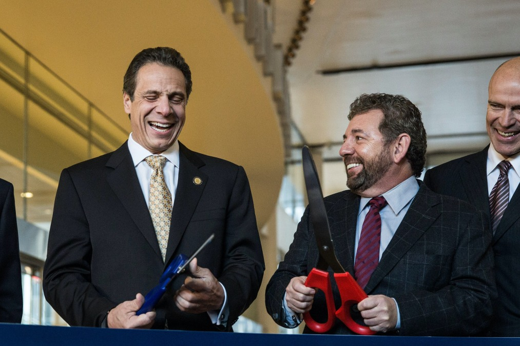 Governor Andrew Cuomo cuts a ribbon with New York Knicks owner James Dolan.