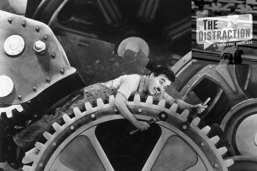 """A still image of a very stressed out Charlie Chaplin from his film """"Modern Times."""""""