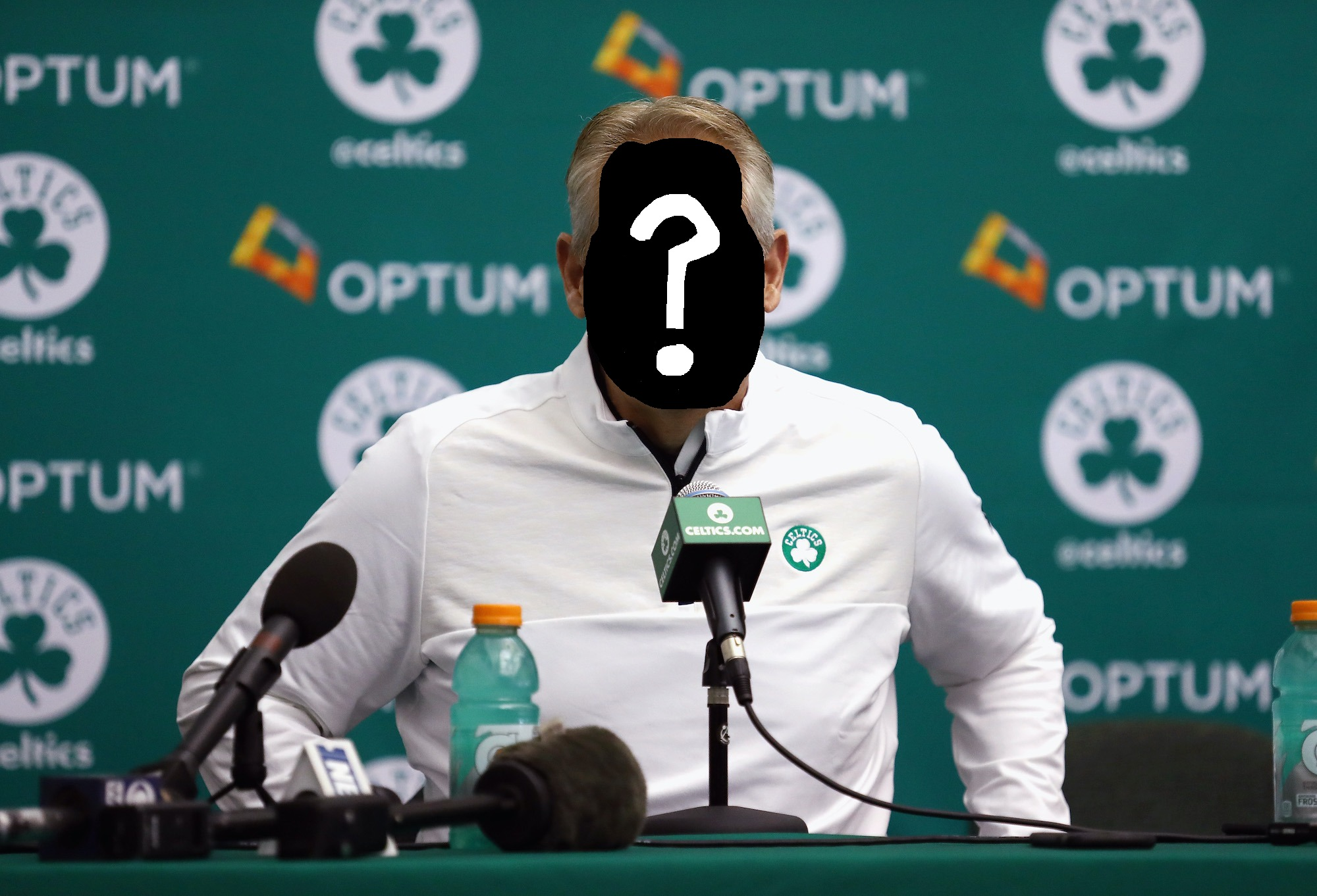 A mysterious, unknown NBA general manager, sitting in front of a Celtics backdrop and speaking into a Celtics-branded microphone.