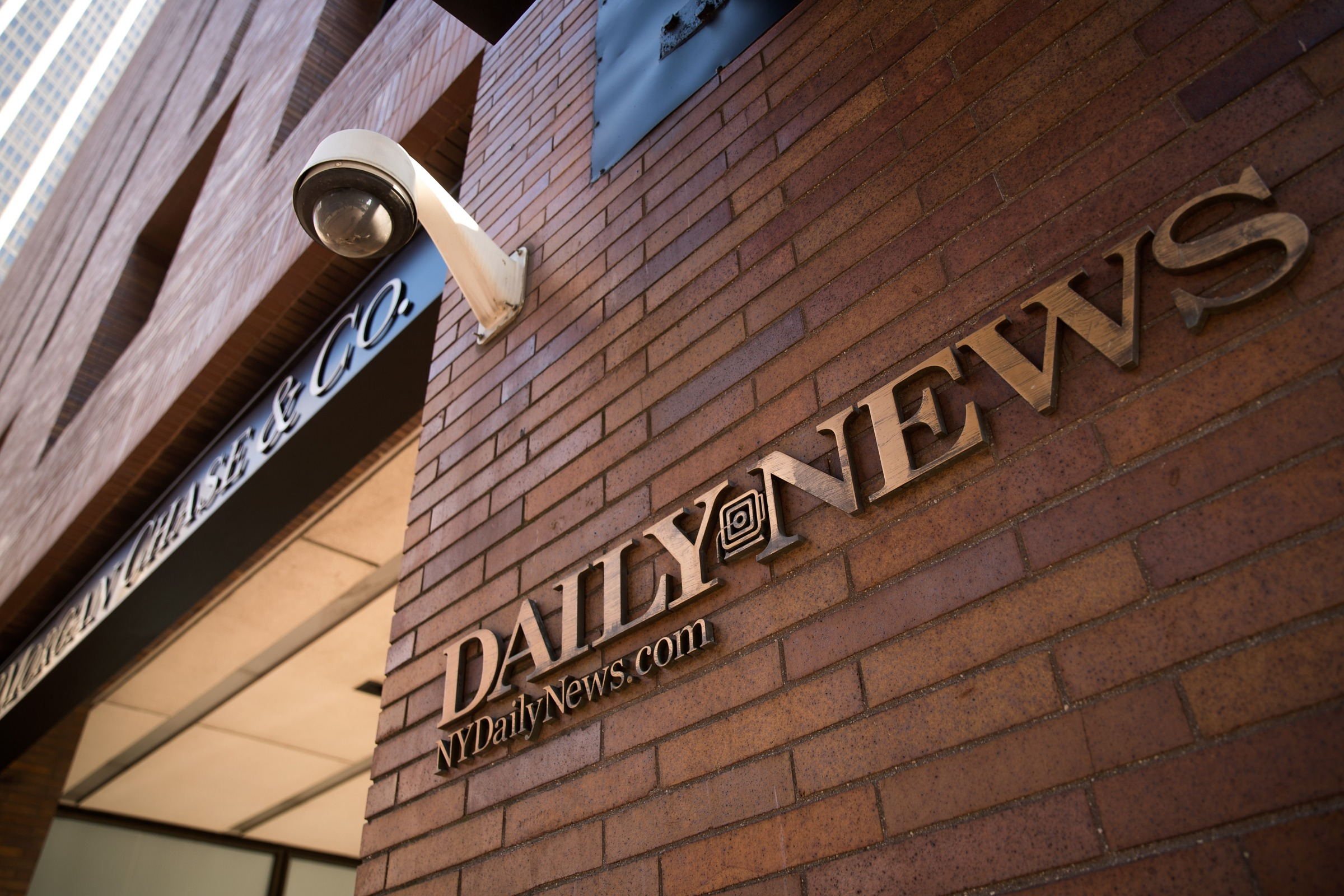 Signage for the New York Daily News is displayed on the facade of their Broad Street office, September 5, 2017 in New York City. Tronc, the publisher of the Chicago Tribune and The Los Angeles Times newspapers, announced on Monday that is had purchased The New York Daily News. Previously owned by Mort Zuckerman, Tronc paid one dollar in cash plus the assumption of liabilities to purchase the nearly 100-year old tabloid newspaper.