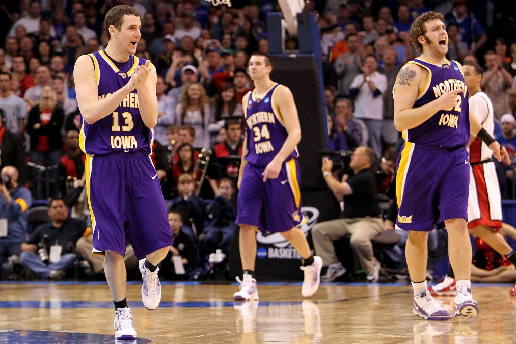 Three big boys from Northern Iowa in their big purple shorts.