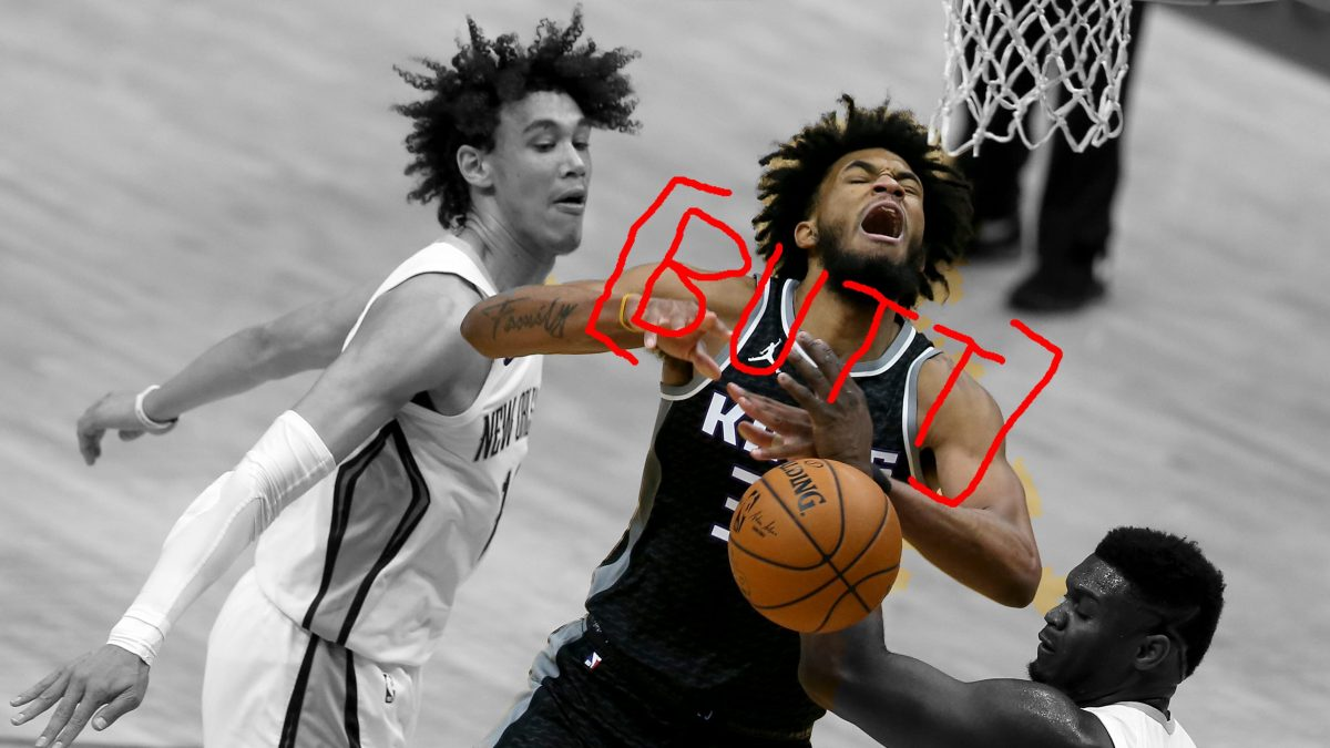 Marvin Bagley III pulls a face while losing the ball to Zion Williamson