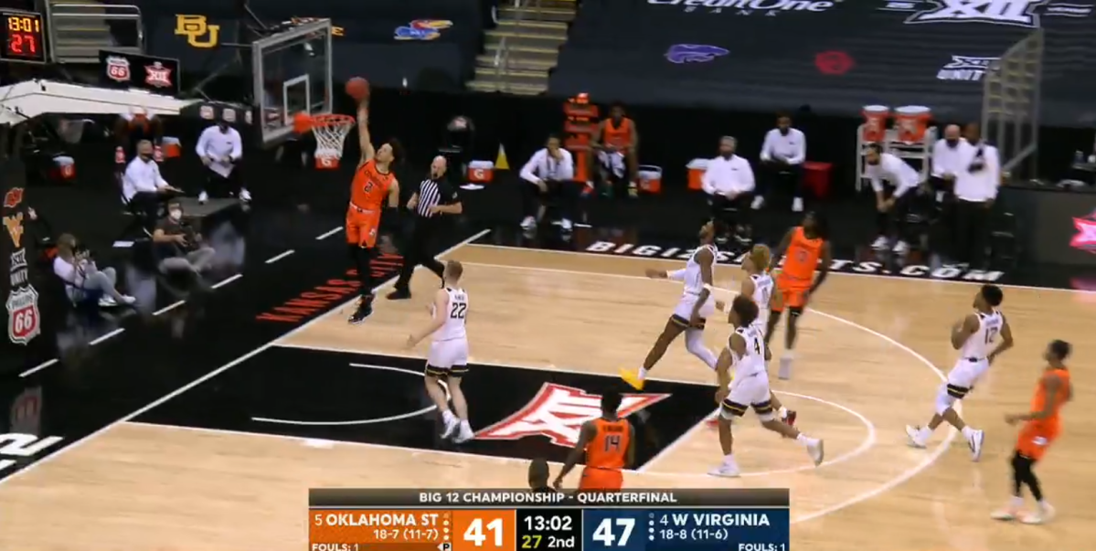 Cade Cunningham goes up for a dunk