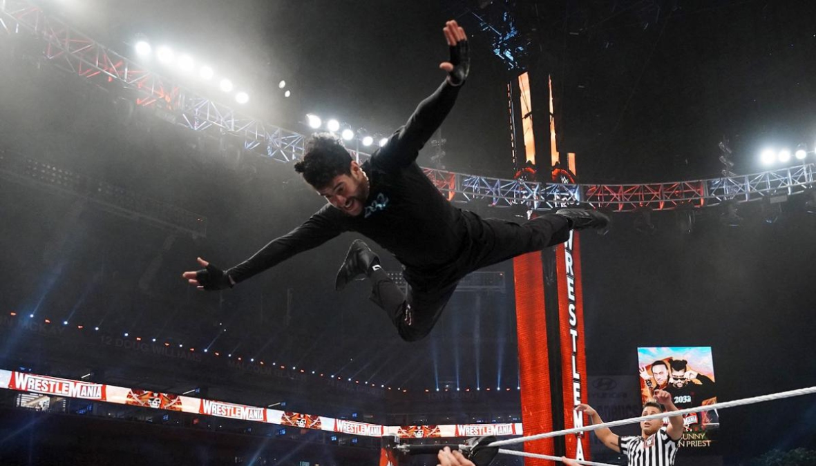 Bad Bunny flies to the outside at WrestleMania 37