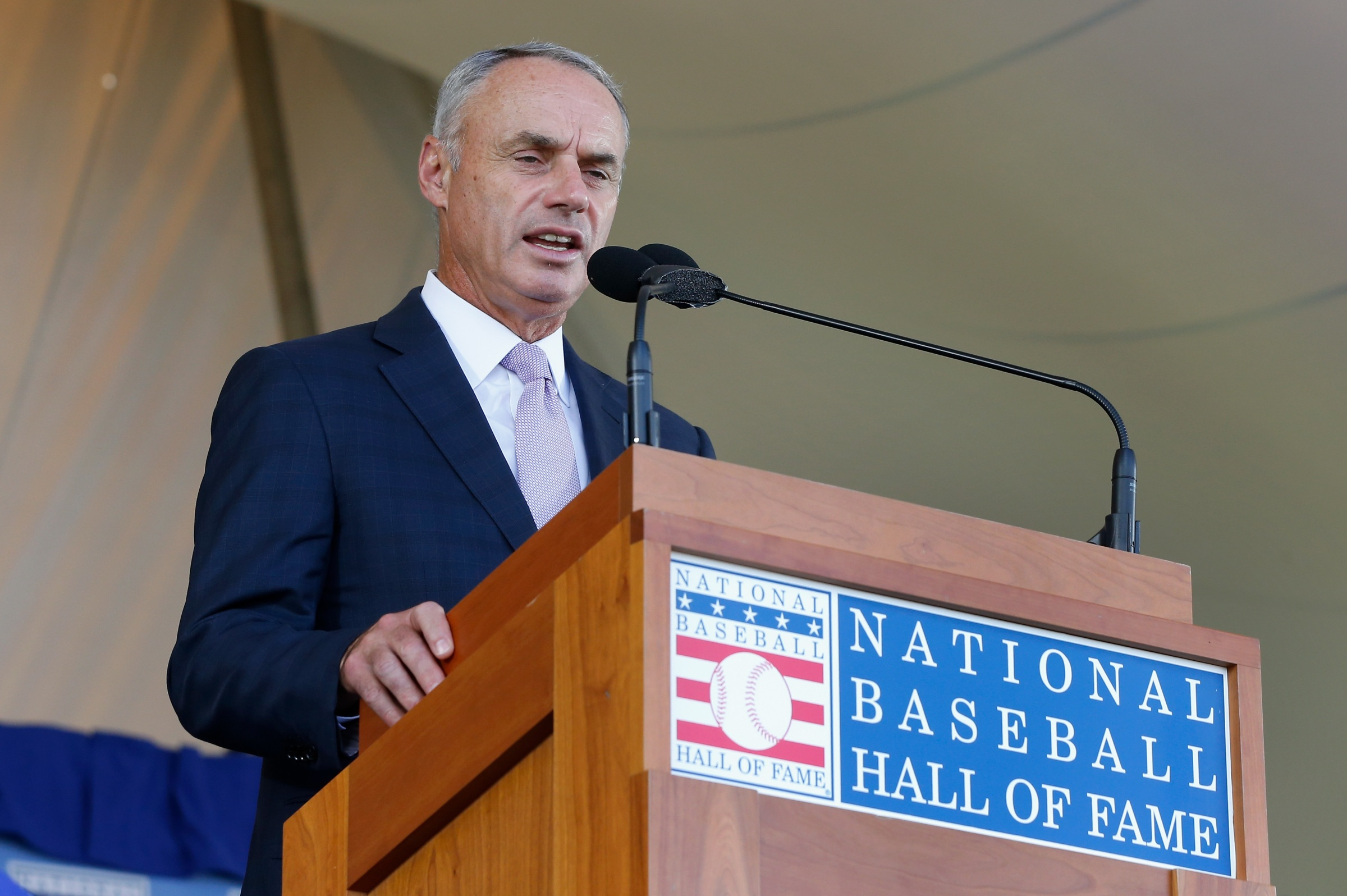 MLB Commissioner Rob Manfred, seen here in Cooperstown, being weird.