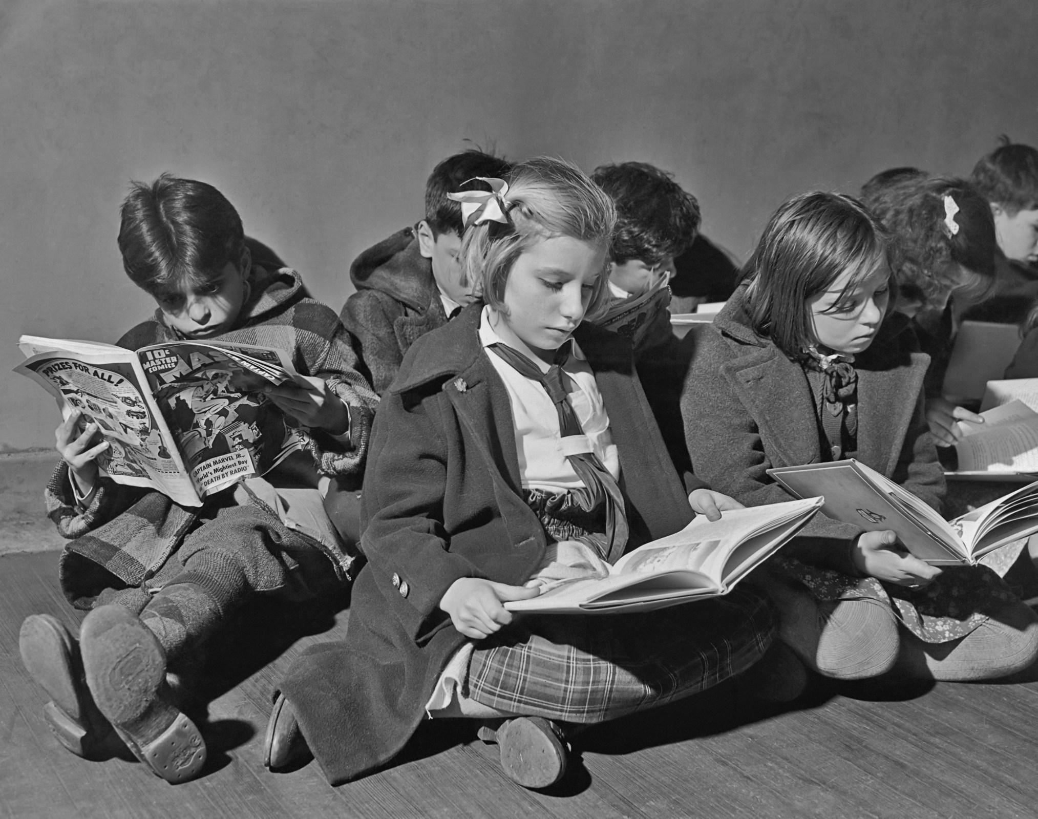 Children read books and comics in 1942.