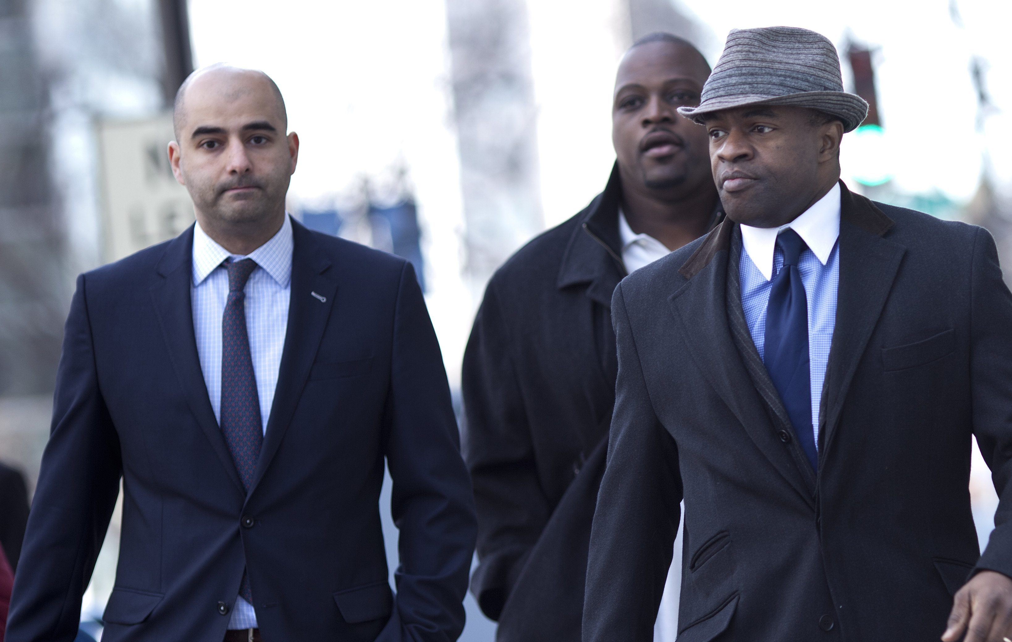 WASHINGTON - MARCH 4: DeMaurice Smith (R), NFLPA executive director, arrives with NFL Players Association Spokesman George Atallah (L) and Kansas City Chiefs player Brian Waters (C) for an extra day of negotiations at the Federal Mediation and Conciliation Service building March 4, 2011 in Washington, DC. Representatives from the National Football League (NFL) and National Football League Players' Association (NFLPA) continue to negotiate a collective bargaining agreement between players and owners during a 24 hour extension in negotiations. (Photo by Brendan Smialowski/Getty Images)