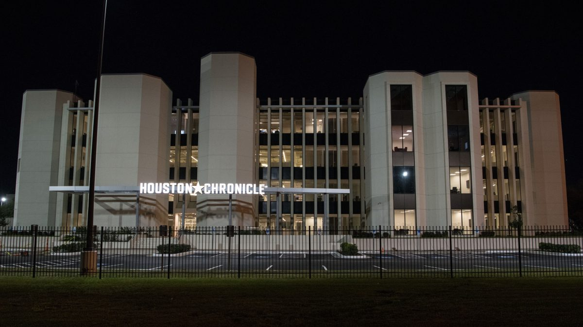 The front of the Houston Chronicle building at night