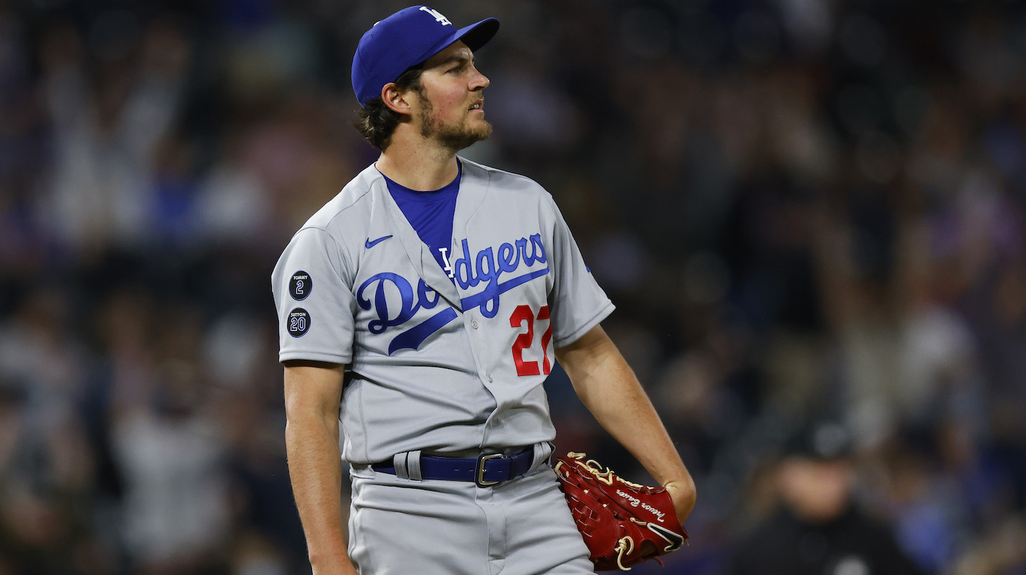 DENVER, CO - APRIL 2: Starting pitcher Trevor Bauer #27 of the Los Angeles Dodgers reacts after giving up a two run home run to Ryan McMahon of the Colorado Rockies during the seventh inning at Coors Field on April 2, 2021 in Denver, Colorado. (Photo by Justin Edmonds/Getty Images)