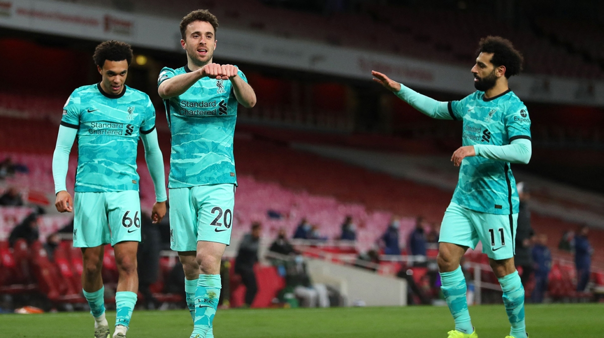 Liverpool's Portuguese striker Diogo Jota (2nd L) celebrates scoring his team's second goal during the English Premier League football match between Arsenal and Liverpool at the Emirates Stadium in London on April 3, 2021.