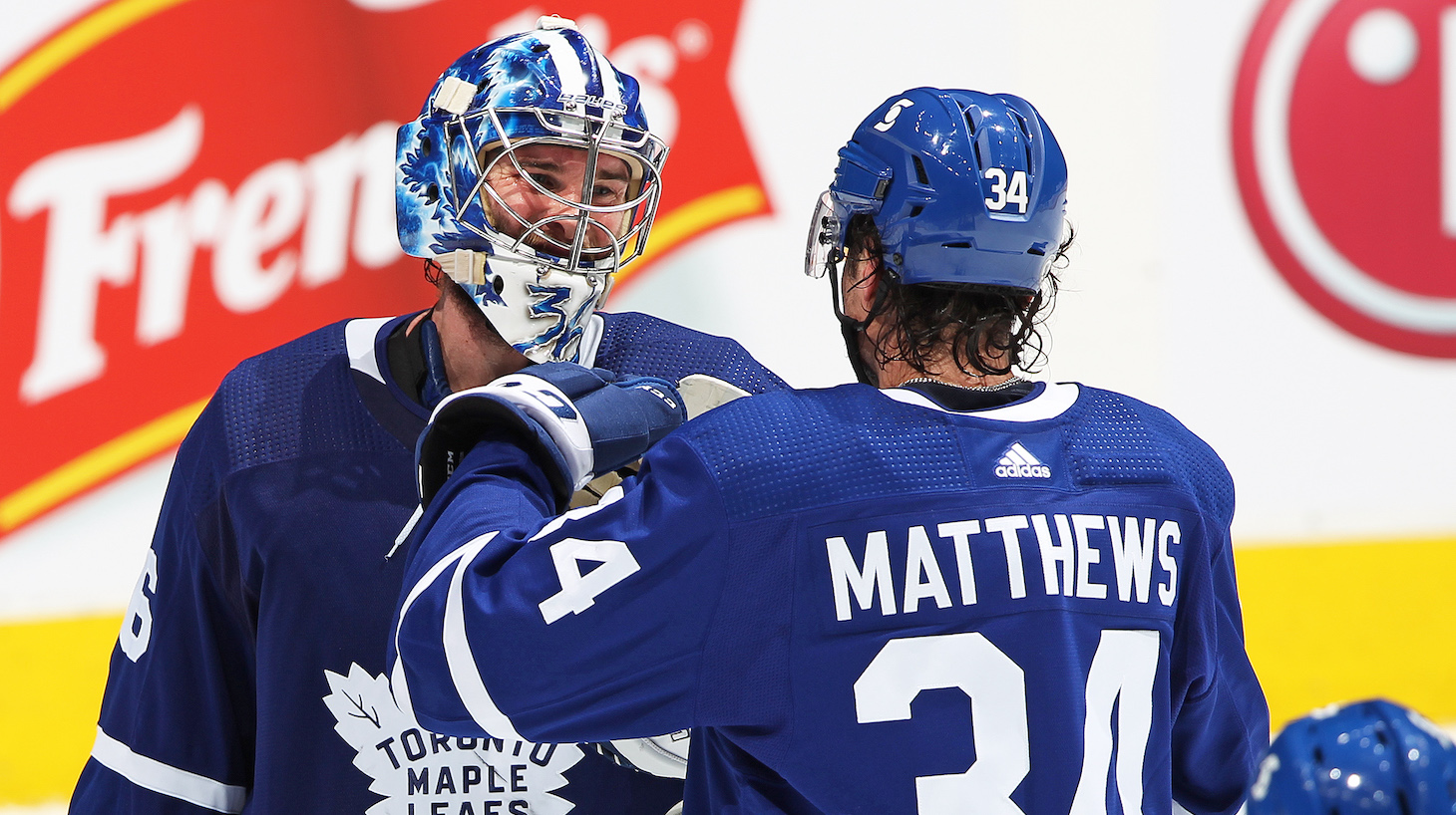 TORONTO, ON - APRIL 7: Jack Campbell #36 of the Toronto Maple Leafs is congratulated by teammate Auston Matthews #34 for breaking the consecutive win record for a Leaf against the Montreal Canadiens during an NHL game at Scotiabank Arena on April 7, 2021 in Toronto, Ontario, Canada. The Maple Leafs defeated the Canadiens 3-2. (Photo by Claus Andersen/Getty Images) *** Local Caption *** Jack Campbell; Auston Matthews