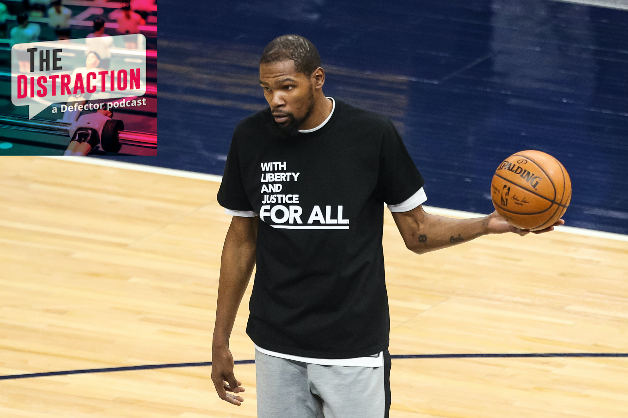 Kevin Durant warms up before Tuesday's game against the Timberwolves in a meaningful t-shirt.