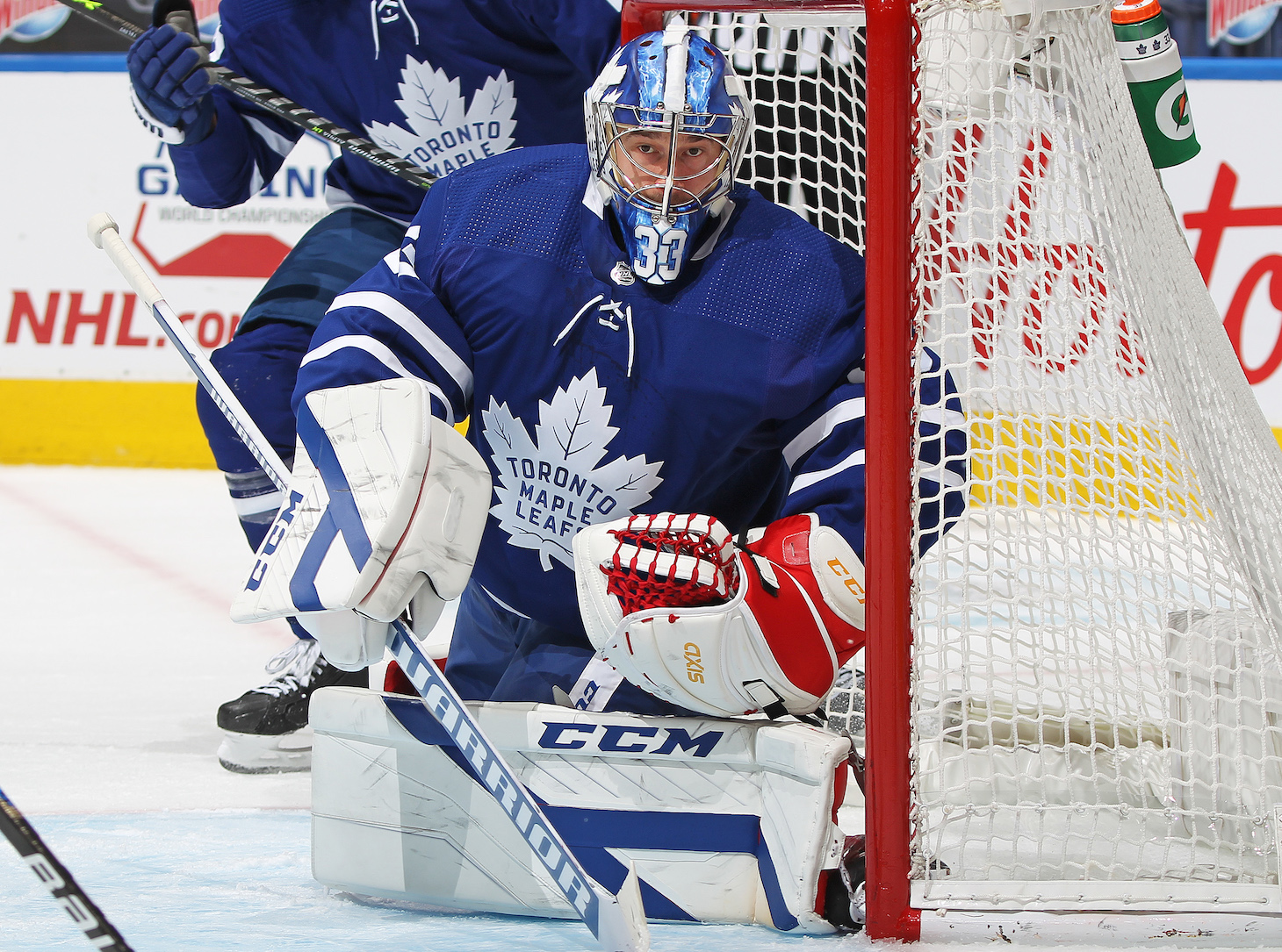 TORONTO, ON - APRIL 13: David Rittich #33 of the Toronto Maple Leafs protects the corner against the Calgary Flames during an NHL game at Scotiabank Arena on April 13, 2021 in Toronto, Ontario, Canada. (Photo by Claus Andersen/Getty Images) *** Local Caption *** David Rittich