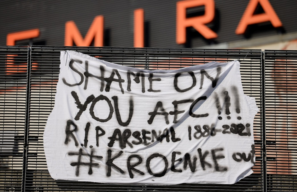 """An anti-European Super League banner is pictured outside the Emirates Stadium, home of English Premier League football club Arsenal, in north London on April 19, 2021. - Twelve of Europe's biggest clubs on Monday said they planned to launch a breakaway Super League, despite the threat of an international ban for them and their players. """"AC Milan, Arsenal, Atletico Madrid, Chelsea, Barcelona, Inter Milan, Juventus, Liverpool, Manchester City, Manchester United, Real Madrid and Tottenham Hotspur have all joined as founding clubs,"""" said a statement by the group. (Photo by Tolga Akmen / AFP) (Photo by TOLGA AKMEN/AFP via Getty Images)"""