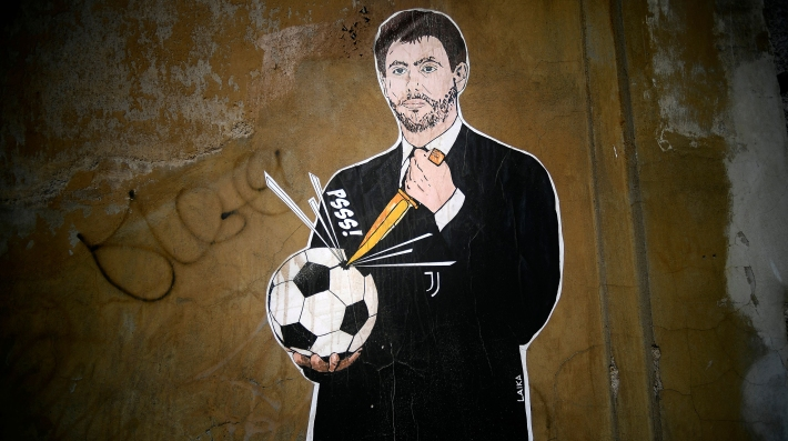 """A photo shows a grafiti entitled """"The failed coup"""" (Il Golpe Fallito) by Italian artist Laika, showing Juventus President Andrea Agnelli puncturing a football, near the headquarters of the Italian Football Federation in Rome on April 21, 2021."""