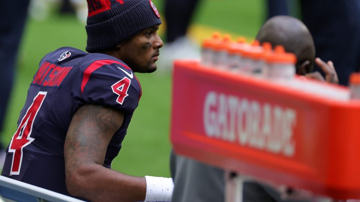 Quarterback Deshaun Watson of the Houston Texans looks on from the bench late in the fourth quarter of the game against the Cincinnati Bengals at NRG Stadium on December 27, 2020 in Houston, Texas.