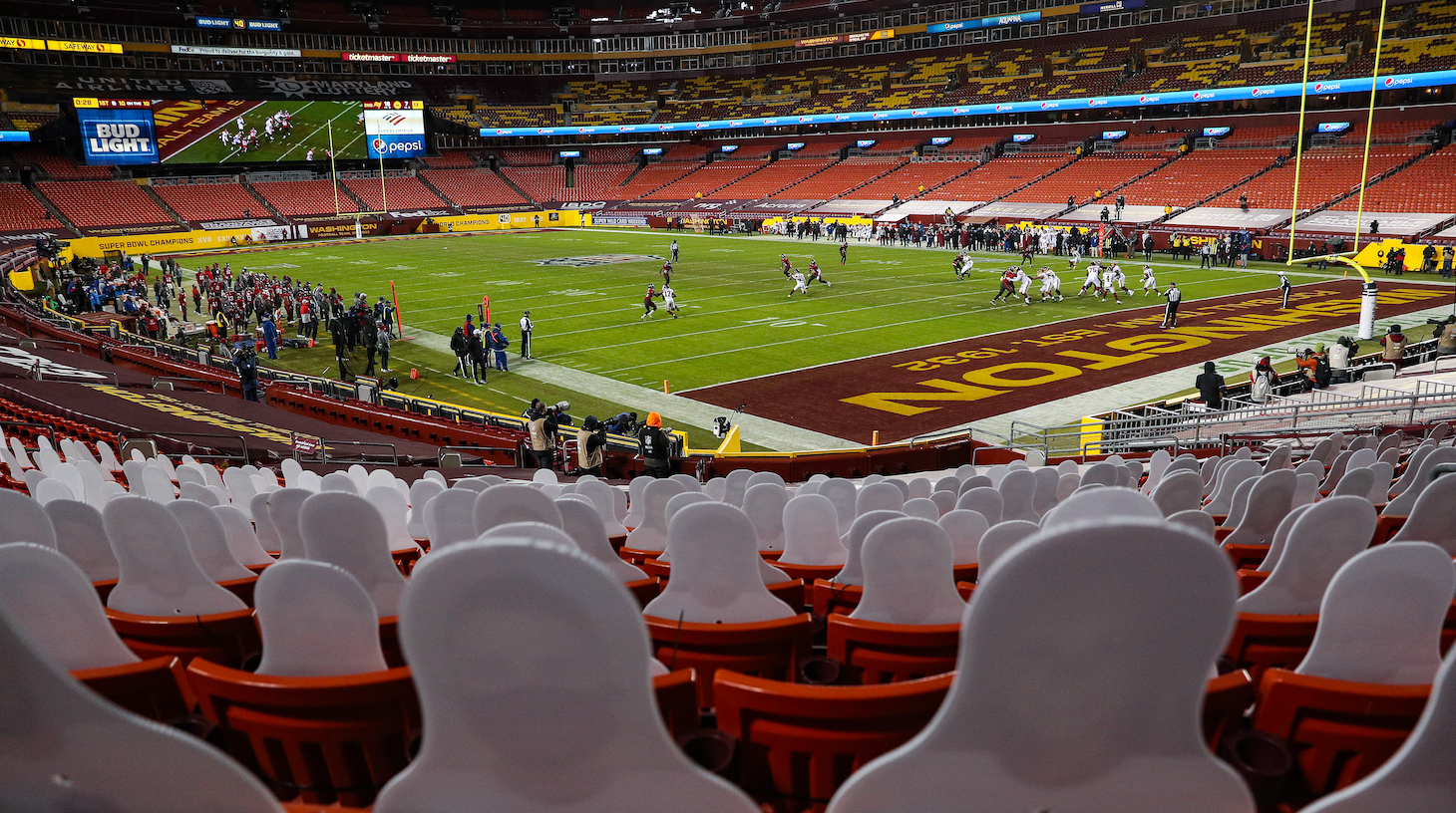 LANDOVER, MARYLAND - JANUARY 09: Cardboard cutouts are seen in a general view as the Tampa Bay Buccaneers play the Washington Football Team during the second quarter of the NFC Wild Card Playoff Round at FedExField on January 09, 2021 in Landover, Maryland. No fans were permitted due to health concerns over the Covid-19 pandemic. (Photo by Patrick Smith/Getty Images)