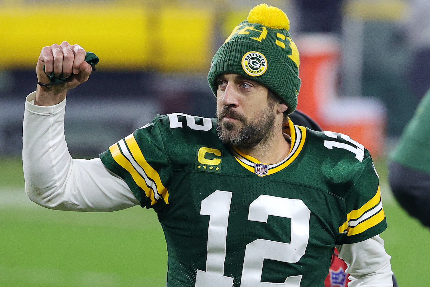 GREEN BAY, WISCONSIN - JANUARY 16: Aaron Rodgers #12 of the Green Bay Packers celebrates defeating the Los Angeles Rams 32-18 in the NFC Divisional Playoff game at Lambeau Field on January 16, 2021 in Green Bay, Wisconsin. (Photo by Stacy Revere/Getty Images)