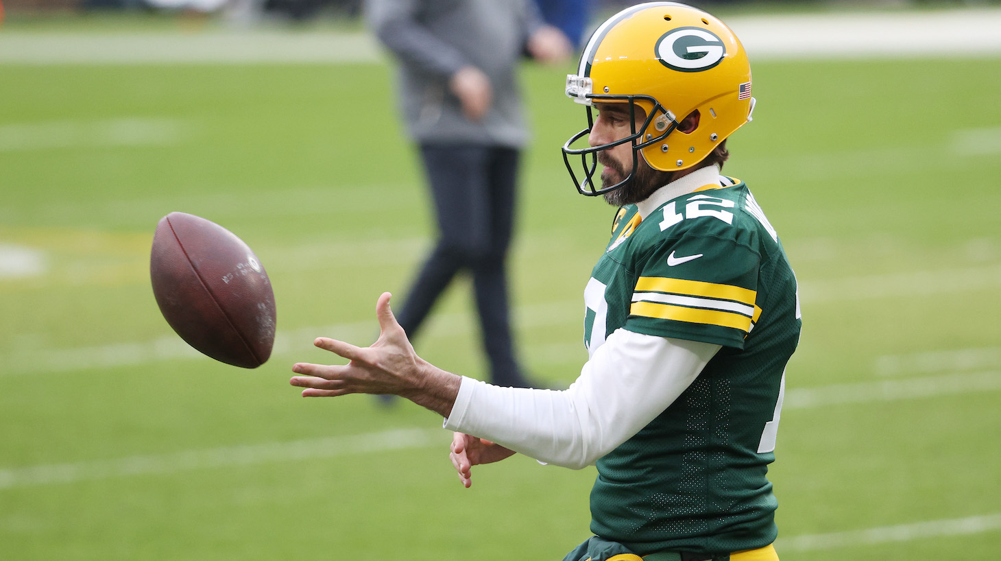 GREEN BAY, WISCONSIN - JANUARY 24: Aaron Rodgers #12 of the Green Bay Packers warms up prior to their NFC Championship game against the Tampa Bay Buccaneers at Lambeau Field on January 24, 2021 in Green Bay, Wisconsin. (Photo by Dylan Buell/Getty Images)