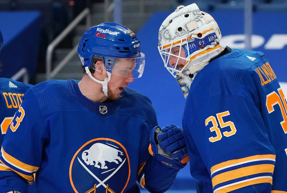 BUFFALO, NY - JANUARY 26: Jeff Skinner #53 of the Buffalo Sabres congratulates Linus Ullmark #35 after beating the New York Rangers at KeyBank Center on January 26 , 2021 in Buffalo, New York. (Photo by Kevin Hoffman/Getty Images)