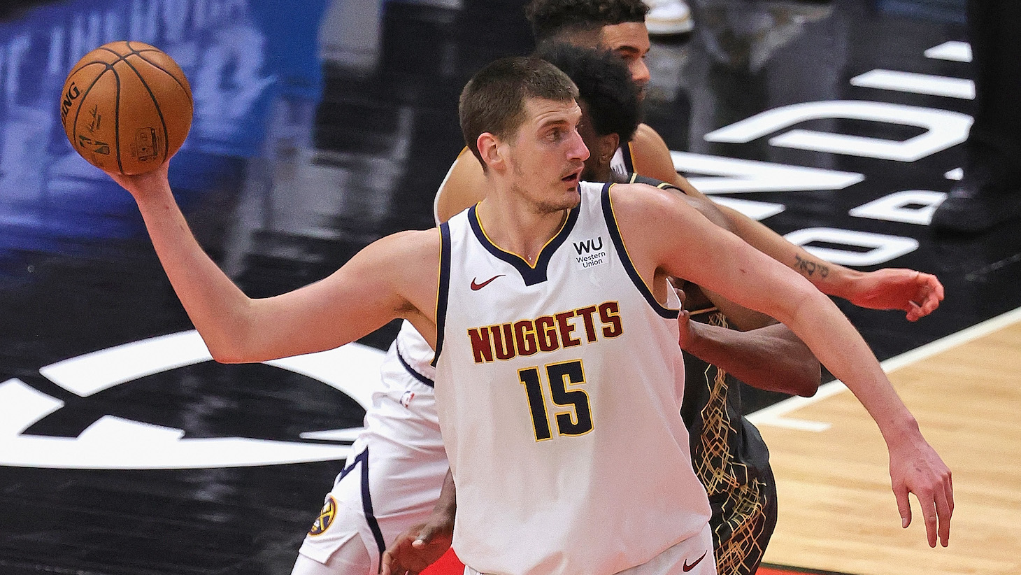 CHICAGO, ILLINOIS - MARCH 01: Nikola Jokic #15 of the Denver Nuggets passes downcourt against the Chicago Bulls at the United Center on March 01, 2021 in Chicago, Illinois. NOTE TO USER: User expressly acknowledges and agrees that, by downloading and or using this photograph, User is consenting to the terms and conditions of the Getty Images License Agreement. (Photo by Jonathan Daniel/Getty Images)
