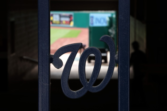 """A gate with the Nationals """"W"""" inside Nationals Park."""