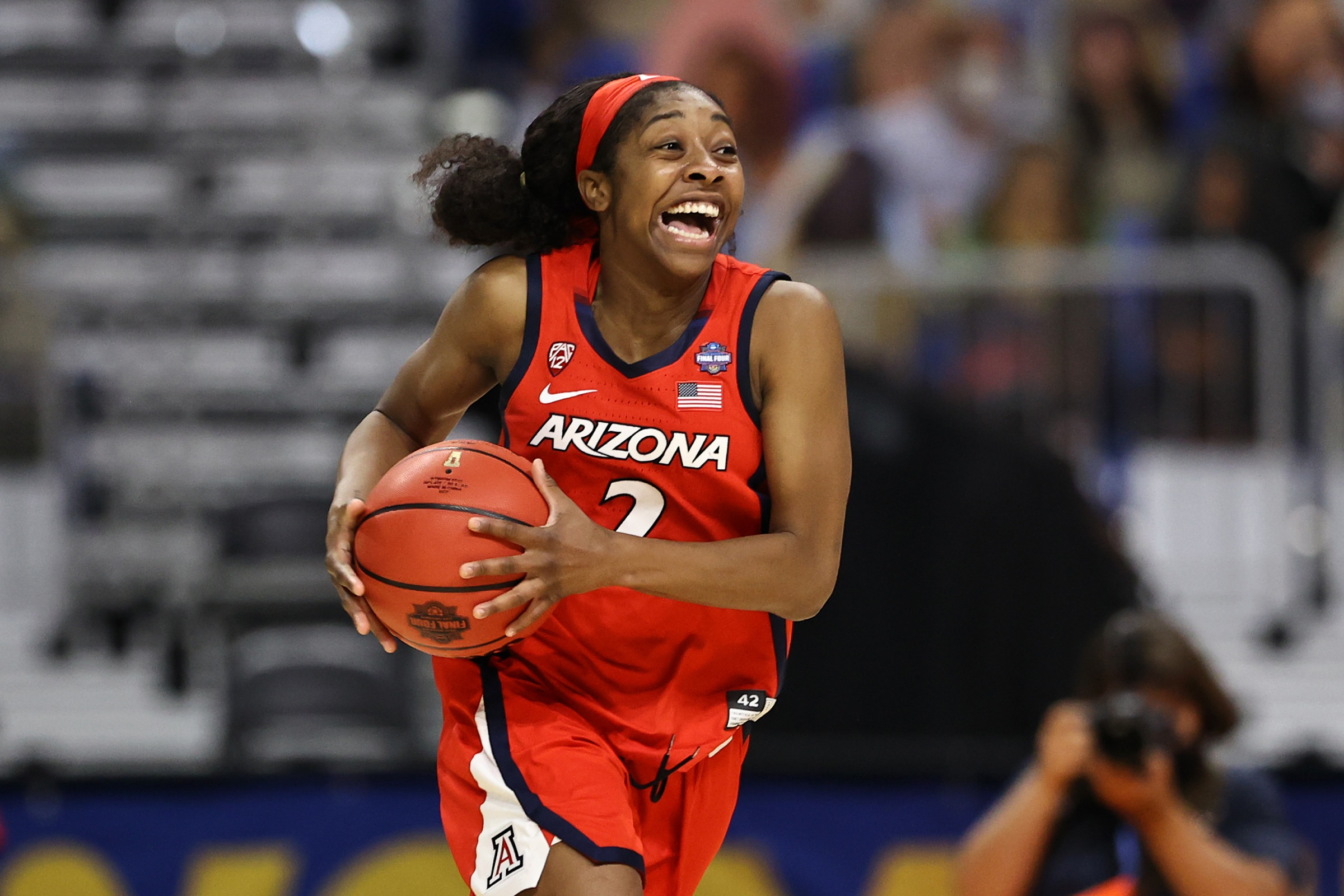 Aari McDonald #2 of the Arizona Wildcats celebrates after defeating the UConn Huskies during the third quarter in the Final Four semifinal game of the 2021 NCAA Women's Basketball Tournament at the Alamodome on April 02, 2021 in San Antonio, Texas. (